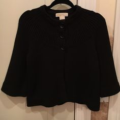 NWOT Michael Kors Knit Sweater This is a NWOT Michael Kors knit black poncho style sweater. It has 3/4 selves. It does not come with tags but it is in brand new condition. MICHAEL Michael Kors Sweaters Shrugs & Ponchos