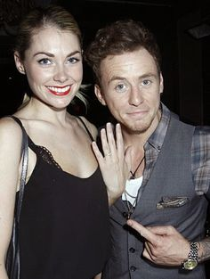 """""""At the #JeansForGenes charity event in London, McFly's Danny Jones points out the engagement ring he recently put on Georgia Horsley's finger."""""""