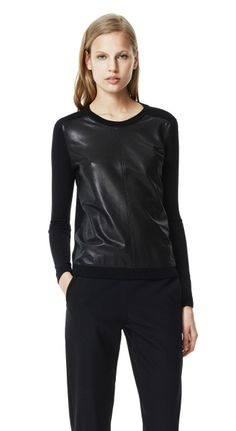 Redefine leather with this Yulia L sweater.