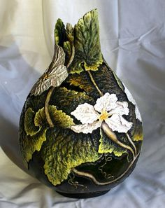 Gourd art by Gary Kvalheim, this piece from the Wisconsin Gourd Society, pushes the boundaries of craftsmanship by using this non-traditional artistic medium.