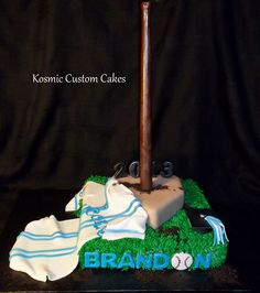 Baseball Cake For more pics - Find us on Facebook TODAY! Kosmic Custom Cakes
