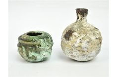 AKI MORIUCHI (born 1947); a small heavily textured stoneware vase, height 10cm with a smaller ves