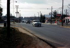 Maple Avenue and Park Street looking West in the mid-1950s. That's the present Michael Renee building on the left (then a garage), and then Lowes Building Supply (now Whole Foods). The Atlantic Station on the right and the building past it are now Vienna Presbyterian's parking lot. You can just make out the Railroad Crossing sign between the first two automobiles. Photo courtesy Mark Aceto.