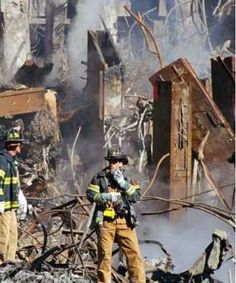 Workers at the wreckage site.    http://rrea.com/wp-content/uploads/2009/09/9-11_thermite1.jpg