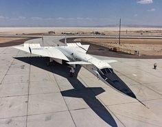XB-70A parked on a ramp at Edwards Air Force Base in 1967.  Originally designed as a Mach 3 bomber, the XB-70A never went into production and instead was used for flight research involving the Air Force and NASA's Flight Research Center FRC, which was a predecessor of today's NASA Dryden Flight Research Center. The aircraft's shadow indicates its unusual planform. This featured two canards behind the cockpit, followed by a large, triangular delta wing. The outboard portions of the wing were…