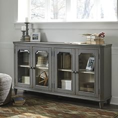 With its distressed vintage paint finish, fluted details and graceful styling inspired by French provincial furniture, this exquisite cabinet puts the accent on très chic living. Adjustable shelved storage is abundantly practical, be it in a dining room, bedroom or entryway.