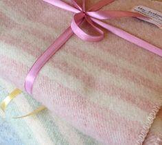 """<a href=""""https://threebagsfull.ca/accessories/macausland-woolen-blankets/"""">MacAusland Lap Blankets</a>"""
