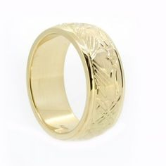 Yellow gold mens wedding ring, 8.0mm wide band x 2.0mm deep with hand engraved raised pattern with brushed finish, polished side rails, half round profile.