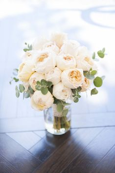 cabbage roses, with eucalyptus, / bridesmaids bouquet size will be a few roses with more greenery