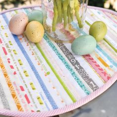 If you have some pretty pastel fabric scraps handy, turn them into a sweet Easter decoration. This Easy Striped Easter Table Runner is a fun way to dress up your table for Easter. Impress your guests with your sewing skills and holiday spirit.