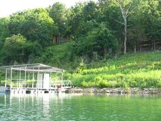 This type of property doesn't come along very often! Beautiful 3.07 acre Bull Shoals Lake home site, private cove, year round lake view, 2 stall covered boat dock w/solar power, one boat lift, swim deck, 25 x 36 Log two car garage w/bathroom and kitchenette, pad for RV septic & 220 electric hookup. Insulated with lots of storage space. All appliances go with property. Several building sites on the acreage. Light deed restrictions to keep the area nice in Yellville AR
