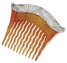 Here is a beautiful, signed Tiffany & Co. comb in diamonds and tortoiseshell. It is a platinum, seed pearl, and European-cut diamond hair comb c. 1910, sold for $11,875