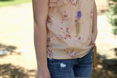 Small details.. Wearing a floral top and jean shorts on #thatotherhannahblog. Check it out on thatotherhannah.com.