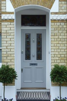 Looking to paint your front door a different color? These designers reveal their favorite front door colors. Grey Front Doors, Victorian Front Doors, Front Door Porch, Front Doors With Windows, House Front Door, Front Door Colors, Glass Front Door, House Doors, Victorian Homes