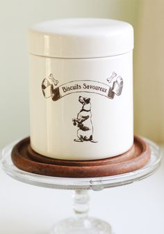 "Oliver And Friends Treat Jar 23.99 at shopruche.com. This ceramic treat jar is especially designed for your lovable pet. With a vintage print on the front, this jar is chic enough to display on your counter.6.5""H x 5.25""W, 17"" circumference"