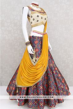 Dress yellow Pure silk multi color garba and navratri chaniya choli highlighted with beige si. Pure silk multi color garba and navratri chaniya choli highlighted with beige silk embroidered work blouse & royal yellow pure chiffon dupatta. Garba Chaniya Choli, Garba Dress, Navratri Dress, Sangeet Outfit, Indian Fashion Dresses, Indian Gowns Dresses, Indian Designer Outfits, Indian Outfits, Choli Blouse Design