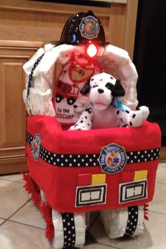 This is a Diaper Cake I made for my daughter in law and sons baby shower. My son is a Firefirefigher /Paramedic and the theme for the shower was firefighting. It's a Boy!!