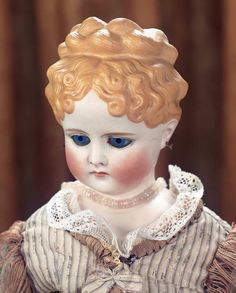 German Bisque Lady Doll with Glass Eyes and Braided Coronet