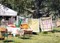 Vintage tablecloths hung from a clothesline.