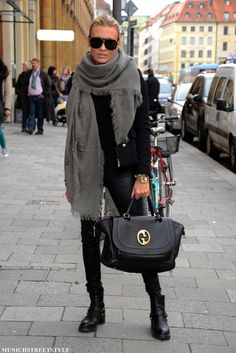 great edgy downtown look    really big scarf with wool coat - leather pants and short riding books and black leather bag