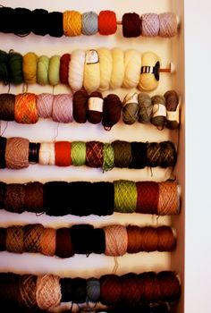 Yarn storage on dowels hung from clothes rod hardware