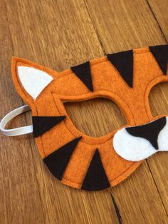 Beautiful handmade soft felt Tiger mask. Perfect for dress-ups and inspiring imaginative play. Masks are crafted, cut and lovingly embellished by hand. All masks are made from at least 2 layers of highest quality Merino wool felt for comfort and durability and elastic is double