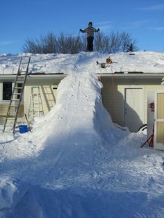 This photo proves you don't have to live near a ski lodge to hit the slopes! All you need for this DIY ski slope is tons of snow, a one-story...