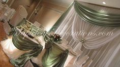 Toronto Wedding Decorations - Custom Backdrop and Head Table Draping Design by Mapleleaf Decorations in Sage green and and ivory sheer fabrics at Le Parc Banquet Hall in Thornhill. Contact us for more info www.MapleleafDecorations.com