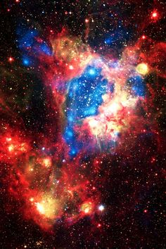 "Starburst Cluster NGC 1929 in the Large Magellanic Cloud This cluster is creating shockwave ""superbubbles"" that are triggering chain reactions of supernova explosions. This image is a composite of three light wavelengths, X-rays are represented as blue, visible light as yellow, and infra-red light as red."
