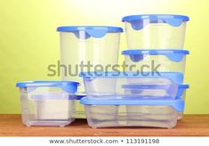 Plastic containers for food on wooden table on green background Plastic Food Containers, Food Storage Boxes, Green Backgrounds, Wooden Tables, Photo Editing, Stock Photos, Wood Tables, Editing Photos, Photo Manipulation