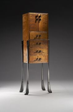 http://www.finewoodartists.com/gallery/hubel/sterling_cabinet.jpg
