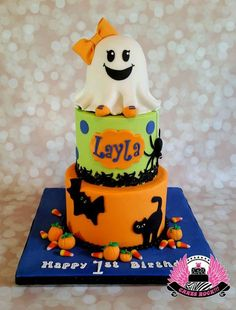 """* This is one of my favorite cakes EVER! I just love everything about it. But I'm a Halloween nut, too. The precious ghost was inspired by Cuteology Cakes' adorable Girly Ghost cake. The ghost is also the smash cake. She is a 4"""" round cake with a half ball cake on top, vanilla with white chocolate buttercream. Both tiers of the main cake are strawberry marble cake with strawberry buttercream filling. I giggle every time I look at the googly-eyed spider crawling on the ..."""