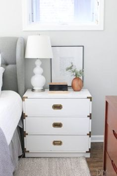 White campaign dresser with a wood vase styled on top. With the new season comes a few tweaks around my home. Here's my fall home tour, with easy ideas that you can use to create your own cozy space! Like bringing in plaid and wood accents! Pipe Shelves, Built In Shelves, Built Ins, Diy Playbook, Neutral Paint Colors, Rental Decorating, Floating, Decorating With Pictures, Diy Baby Gate
