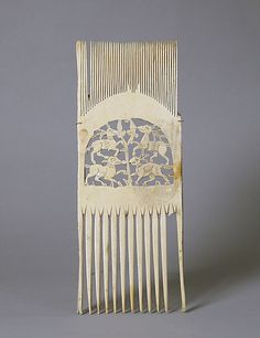 Liturgical Comb;  Date: 12th–13th century;  Culture: French;  Medium: Bone;  Dimensions: Overall: 12 x 4 1/2 x 3/16 in. (30.5 x 11.4 x 0.5 cm);  Classification: Ivories;  Accession Number: 55.29.3