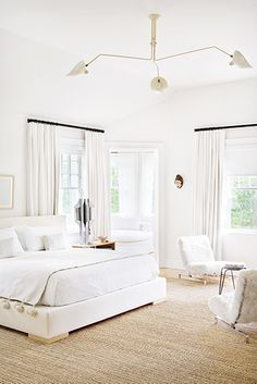 The Best Bright White Spaces//white bedroom, Serge Mouille, Seagrass rug