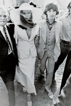We love the white suit for a wedding of the ultimate rock n roll royalty - Bianca Perez-Mora Macias marries Mick Jagger in Yves Saint Laurent, 1971.