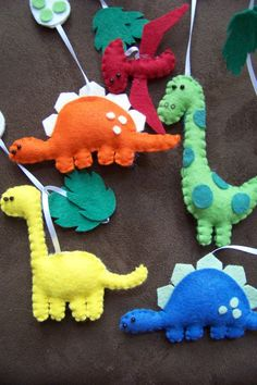 a herd of felt dinosaurs