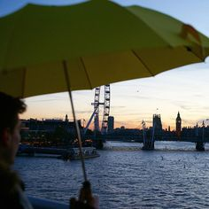 The London Skyline on Waterloo Bridge from underneath a Yellow Telescopic London Undercover Umbrella
