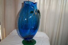 Blenko Art Glass Blue and Green Fish Vase  It is 12 1/2 inches tall X 9 inches wide, 4 1/2 wide at base. It has the original Blenko Lable and in Beautiful Condition. Very Hard to Find Blenko Art Glass