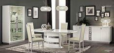 Add a contemporary feel to your dining room with this table. The table features a pedestal base. an 18 extension and high gloss polyester finish in white. This set includes a table. 6 side chairs and china cabinet. White Dining Room Sets, White Dining Chairs, Modern Dining Table, Extendable Dining Table, A Table, Side Chairs, Dining Tables, Dining Sets, Dining Area