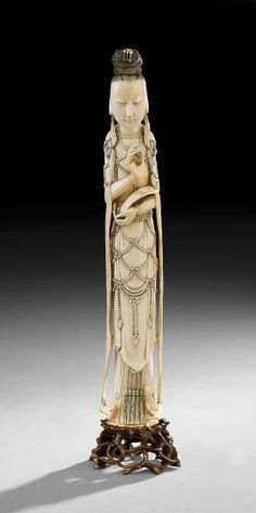 "Chinese Ivory Carving, 19th century, standing figure of the Goddess of Mercy, Kuan Yin, fitted stand, h. 16""."