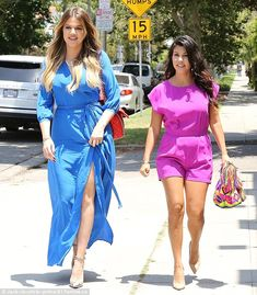 Kourtney and Khloe Kardashian looked bright and colorful on their way to lunch with Kim and pals at Toast in LA June 23, 2014 http://dailym.ai/1pKvmaV