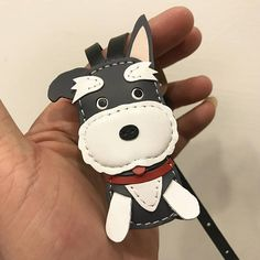 measures: 7 cm X 4 cm , with buckle leather strap version handcut,hand stitched,handmade This lovely Schnauzer keychain is designed and handmade by us, we name it as Our customer name dog , Bingo. This is as picture shown, No custom request or change color, thank you. Made in Taiwan