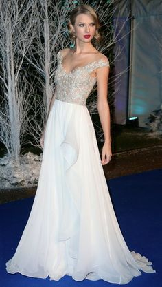 Taylor Swift in a gorgeous Reem Acra dress* (S/S 2014) at the Winter Whites Gala in Aid of Centrepoint in London.