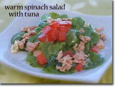 Warm Spinach Salad with Tuna / 6 cups baby spinach 2.5 oz canned light tuna 1 TBS extra virgin olive oil 1 tsp fresh lemon juice 1 medium clove garlic sea salt and pepper to taste *1/2 medium tomato diced Directions:  Combine the olive oil, lemon juice, garlic, and salt and pepper to taste in a small sauce pan and heat until warm. Drizzle over spinach leaves and top with tuna and tomatoes if desired.
