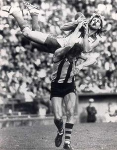 #4 - Warwick Capper kicks 100 goals in a season, 1987     During the Sydney Swan glamour period of the mid-to-late eighties, there was one man who stood above all others - often literally - in his ability to bring people through the gates of the SCG.     Known for his flamboyant style, including the ultra-tight shorts, white boots, long blonde locks and freakish marking ability, Warwick Capper was the number one drawcard in town and up there with the biggest names in the game at the time. Real World Games, Australian Football, Fantasy Football, Sports Stars, Football Players, Cricket, Melbourne, Sydney, White Boots