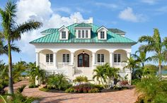 Mediterranean style custom home in Key West, Florida. Cast in place concrete construction, and standing seam copper roof
