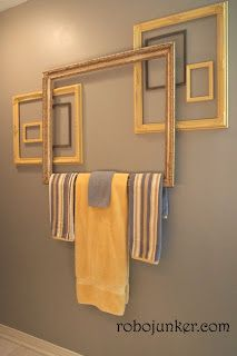DIY use a picture frame as a towel bar. collage of frames decorates the wall... so much cooler than just hanging a towel rod!