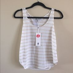 WILDFOX Basic Hiker Tank Brand new lightweight sleeveless top with a scoop neck. Would be great over a bikini, bandeau, or layered with another tank as it is somewhat transparent. True to size.  73% polyester 27% cotton. ***price firm*** Wildfox Tops Tank Tops