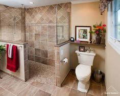 The shower is 3 wide and 7-6 long, with a 36 doorway. Half wall for towel bar and commode privacy. Good use of granite on top of half walls.